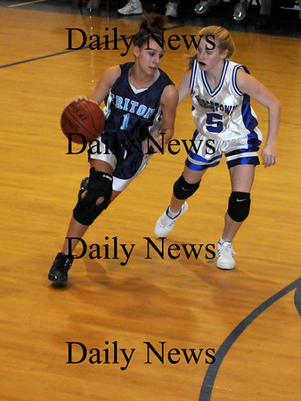 Georgetown: Triton's Brittany Caprio is guarded by  Georgetown's Michelle Reilly during their  game at Georgetown Tuesday night. photo by Jim Vaiknoras/ Newburyport Daily News. Tuesday January 6, 2008