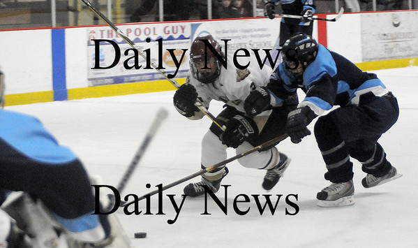 Newburyport: Newburyport Kyle McElroy fights for the puck with a Franklin player during their game Monday at the Graf Rink in Newburyport. photo by Jim Vaiknoras/ Newburyport Daily News January 19, 2009