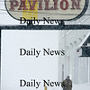 Salisbury: A man braves the weather Sunday afternoon as he walks under the Pavilion sign on Salisbury Beach. photo by Jim Vaiknoras/ Newburyport Daily News. January 18, 2009