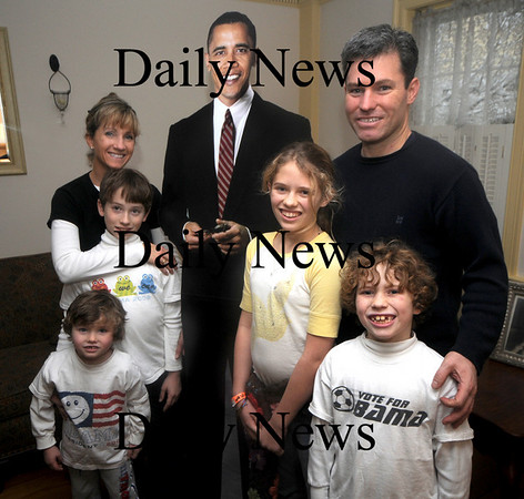 Newburyport: Paul and Susan Acquaviva stand with their children Caroline, 12, Nick, 9, Sam. 7, and Will 4, and a lifesized cut out of Barack Obama at their home in Newburyport. The family is headed to Washington to the Inauguration.photo by Jim Vaiknoras/ Newburyport Daily News. January 18, 2009