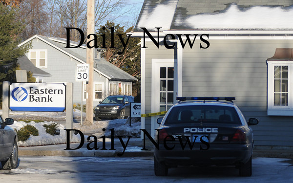 Newburyport:Newburyport police cruiser is park at the scene of a robbery at Easter Bank on Story Ave. photo by Jim Vaiknoras/Newburyport Daily News. Friday January 9, 2008