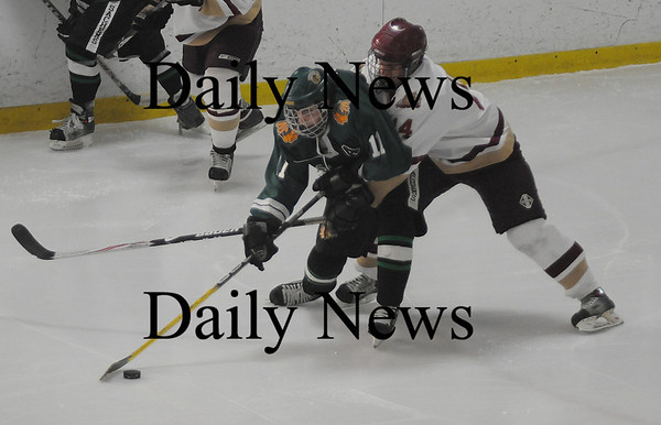 Newburyport:Newburyport's David Freeman fights for the puck with Pentucket's Bob DiSorbo during their game at the Graf Rink in Newburyport. photo by Jim Vaiknoras/Newburyport Daily News January  24, 2009