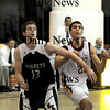Newburyport: Marblehead's Brian Ciccone fights for a rebound with Newburyport's THomas Morris at Newburyport Tuesday night..photo by JIm Vaiknoras. Tuesday January 13, 2009