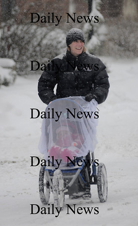 Newburyport:Jen Finch of Newburyport takes goes for a walk with her daughter Emma, 9 months, down Liberty Street  in the snow Sunday morning . Jim Vaiknoras photo/Newburyport Daily News. January 18, 2009