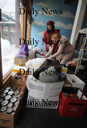 Newburyport: Shari Wilkinson and Dorene Higgings sort food at a food drive at the Tannery Monday afternoon. photo by Jim Vaiknoras/Newburyport Daily News Monday january 20 2009