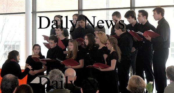 Newburyport: Lisa Zaleski directs the Newburyport High School Varsity Choir at the 16 annual Martin Luther King jr Breakfast at  Newburyport High Monday .photo by Jim Vaiknoras/Newburyport Daily News Monday January 19, 2009