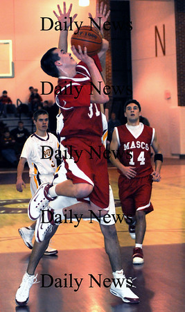 Newburyport: Masco's Collin Burke glides in for two at Newburyport Friday night.photo by Jim Vaiknoras/Newburyport Daily News. Friday January 9, 2009