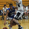 Hamilton:Georgetown's Julio Colon drives on  Hamilton-Wenham's Matt Cook during their game at Hamilton Friday night.photo by Jim Vaiknoras/Newburyport Daily News january 30, 2009