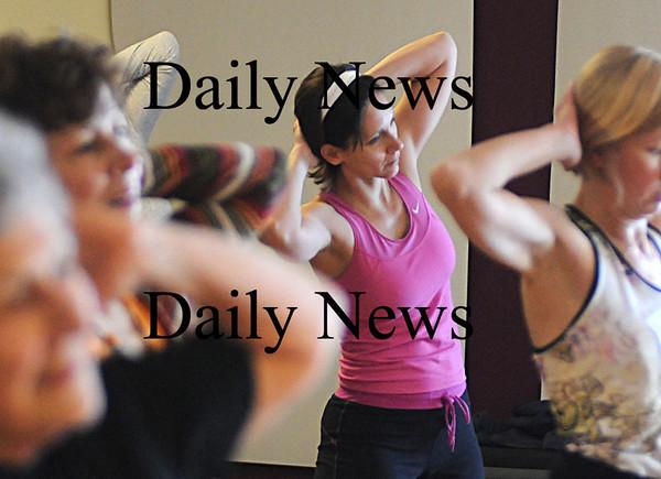 Newburyport:Cheryl Thibault works out in Susan Smith's Zumba class at the Fitness Factory.photo by Jim Vaiknoras/Newburyport News Saturday January 10, 2009