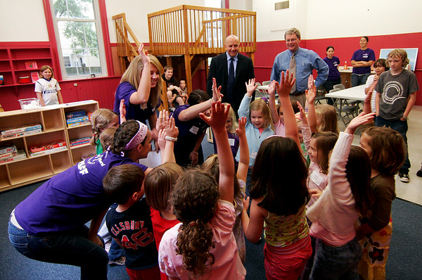 Newburyport: State Representative Mike Costello and Newburyport mayor, John Moak, watch as children from the Little Aces program perform a song and dance. Costello and Moak were taking a tour of the new youth center facilities at the Kelley School, which opened for the summer on Monday. Photo by Ben Laing/Staff Photo