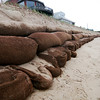Newbury: The sandbags along the dune at Plum Island Center have been exposed during the recent stormy weather, and during Monday nights low tide, damage could be seen to several bags. Photo by Ben Laing/Staff Photo