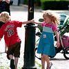 Newburyport: Ethan and Elizabeth Downs, of West Newbury, take a spin around the lamp post at Market Square Tuesday afternoon. Photo by Ben Laing/Staff Photo