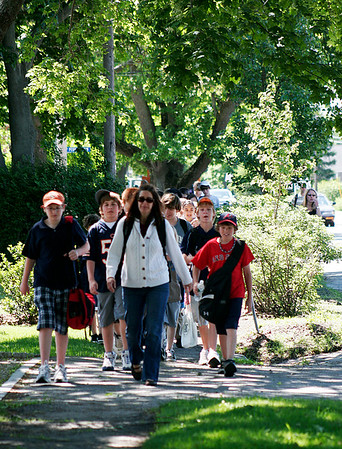 "Newbury: Sixth graders from the Newbury Elementary stoll down High Road in Newbury on Monday morning as part of their ""Walk for Africa"" program. Photo by Ben Laing/Staff Photo"