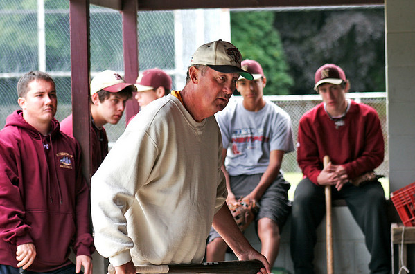 Newburyport: Long time coach of the Newburyport baseball team, Bill Pettingill, talks with his team during Friday's practice, as they go over last minute details for Saturday's North Sectional Championship game against Georgetown. Photo by Ben Laing/Staff Photo