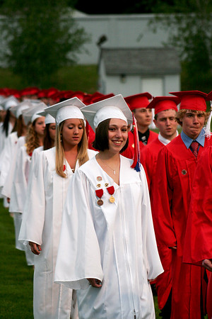 Amesbury: The Amesbury High School Class of 2009 marches on to the field at Landry Stadium for their graduation ceremony Friday night. Photo by Ben Laing/Staff Photo