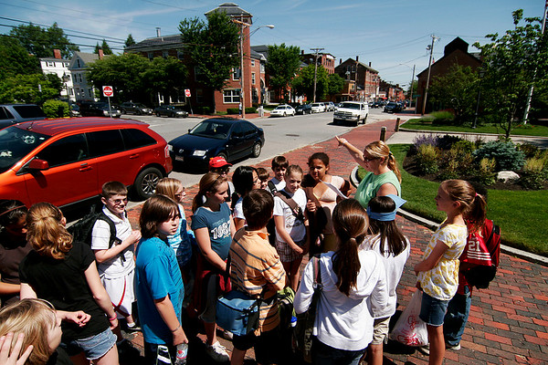 Newburyport: Fifth grade students from Lee Cassidy's class at the Molin Upper Elementary School make a stop on their tour of Newburyport's historic sites, pausing to learn about the Tracey House, which is now the Public Library. Photo by Ben Laing/Staff Photo