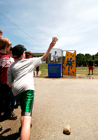 Newburyport: Third grader Chris Halliday throws a ball in an attempt to dunk his principal at the Bresnahan Elementary School, Kristina Davis, during the classes step up day celebration in preperation for their move up to the Molin Upper Elementary School in the fall. Photo by Ben Laing/Staff Photo