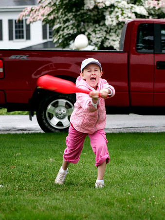 Newbury: Paige Volpone, 7, of Newbury, braved the couldy, wet weather to play a little wiffle ball at the Upper Green on Monday. She, along with a handful of kids and a few parents, wouldn't let the rain keep them cooped up in their houses any longer. Photo by Ben Laing/Staff Photo