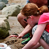 Plum Island: Brianna Gifford, a sixth grader at Amesbury Middle School, and Pam Gilday, a parent chapparone, study a crab found in a tide pool on the class's trip to Sandy Point on Tuesday. Photo by Ben Laing/Staff Photo