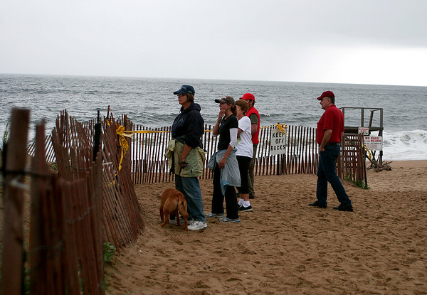 Newbury: A crowd gathers at Plum Island Center to inspect the damage from Monday's storm and high tides. Photo by Ben Laing/Staff Photo