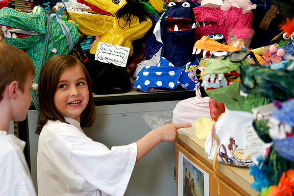 Newbury: Kindergartener Marella Keeler points out her favorite monster statue to Cade McAdams during their art class at Newbury Elementary. Photo by Ben Laing/Staff Photo