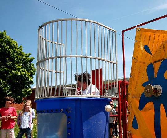 Newburyport: Bresnahan Elementary School principal, Kristina Davis gets dunked by one of her students during the school's step up day for the third grade class. The third grades will be moving up to the Molin Elementary School in the fall. Photo by Ben Laing/Staff Photo