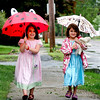 Amesbury: Maggie Deily, left, and Piper Hogg, right, both 5, take a stroll through Amesbury with Piper's mom, Lori Ann, Monday morning, despite the rain. Photo by Ben Laing/Staff Photo