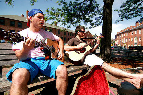 Newburyport: Richie Pace, left, and Rob Cleary, right, play music in Market Square in downtown Newburyport Monday afternoon. Photo by Ben Laing/Staff Photo