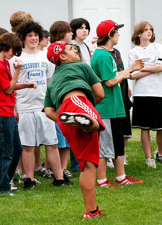 Amesbury: Matt Bremis, a seventh grader at Amesbury Middle School, heaves a softball as far as he can during Monday's field day activites at the school. Photo by Ben Laing/Staff Photo