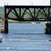 Newburyport: A kayak navigates the channel under the Gillis Bridge along the Merrimack River Monday afternoon. Photo by Ben Laing/Staff Photo