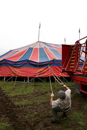 Merrimac: A worker from the Kelly Miller Circus helps raise the big top Tuesday morning as they set up their show in Merrimac along Rt. 110. Photo by Ben Laing/Staff Photo