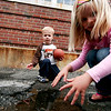 Newburyport: Viive Godtfredsen, 4, and her brother, Bodie, 3, play in the puddles outside the Brown School in Newburyport Monday afternoon. Photo by Ben Laing/Staff Photo