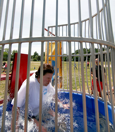 Newburyport: Bresnahan Elementary School principal, Kristina Davis, gets dunked by one of her students during Wednesday's step up day celebration for the third grade class, which will be moving on to the Molin Upper Elementary School in the fall. Photo by Ben Laing/Staff Photo