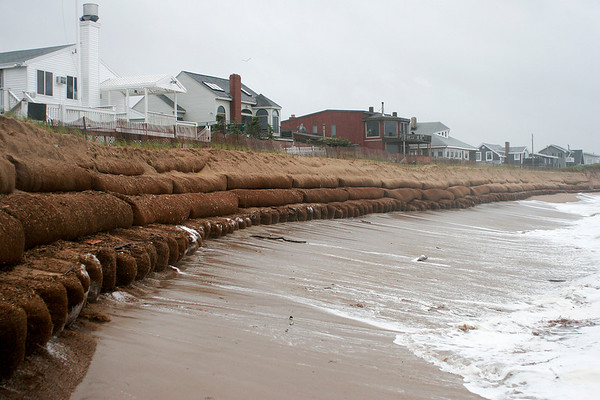 Newbury: The sand bags at Plum Island center are now fully exposed as Monday's storm produced high tides that have washed away much of the newly constructed dune.  Photo by Ben Laing/Staff Photo