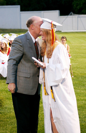 Amesbury: Amesbury High School's principal, Leslie Murray, awards his daughter, Kelly, her diploma as she and the rest of the Class of 2009 graduate at Landry Stadium Friday night. Photo by Ben Laing/Staff Photo