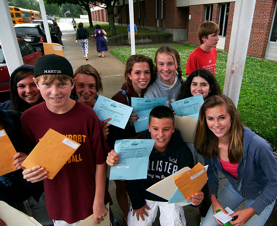 Newburyport: A group of students show off of their report cards as they leave the Nock Middle School in Newburyport for the last time as seventh graders, returning in the fall as the new eight grade class. Today was the last day of school in Newburyport. Photo by Ben Laing/Staff Photo