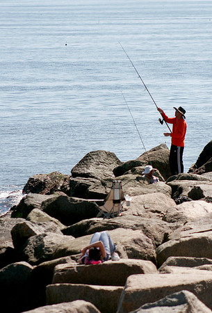 Newbury: With stormy weather predicted all week, people took advantage of Monday's sun to head to Plum Island, whether to fish or catch some rays. Photo by Ben Laing/Staff Photo