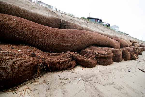 Newbury: The sandbags along the dune at Plum Island Center have been exposed during the recent stormy weather, and during Monday night's low tide damage could be seen to several bags. Photo by Ben Laing/Staff Photo