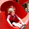 Amesbury: Jake Parsons, 4, of Amesbury, is the victim of some static electricity after sliding down the slide at the Amesbury Town Park on Monday. Photo by Ben Laing/Staff Photo