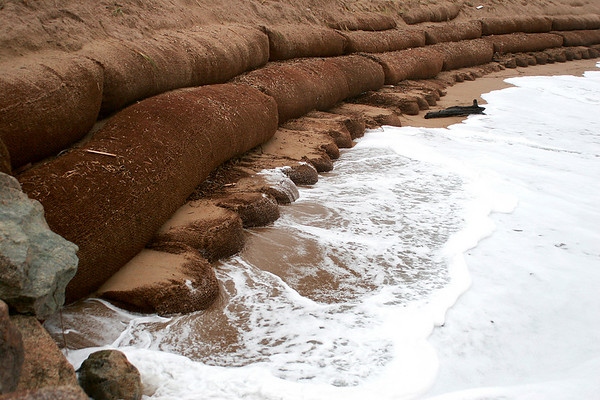 Newbury: Waves were still pounding exposed sandbags at Plum Island Center during high tide on Tuesday. Photo by Ben Laing/Staff Photo