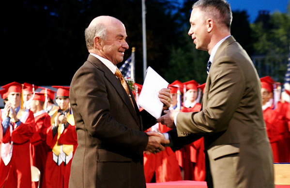 Amesbury: Raymond Bulldock, a Vietnam veteran, receives his diploma along with the Class of 2009 at the Amesbury High graduation ceremony Friday night. Photo by Ben Laing/Staff Photo