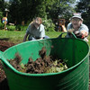 Newburyport;   Hope in Bloom members Julie McIntosh- Shapiro, and  Laura Eisener work on  a sea-themed garden in the Diane Hanson's backyard. Jim Vaiknoras/Staff photo