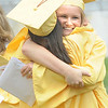 Newburyport: Leah Svoboda hugs one of her classmates after the Newburyport graduation Sunday at World War Memorial Stadium.Jim Vaiknoras/staff photo