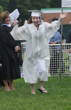 West Newbury: Susan Pepperman throws up her hand  after getting his diploma at the Pentucket Graduation Saturday morning.Jim Vaiknoras/staff photo