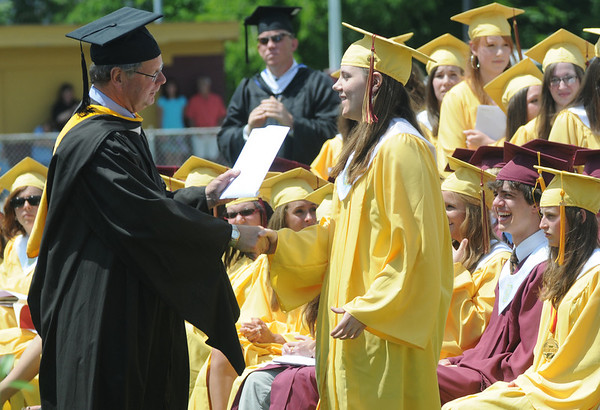 Newburyport: Rachel Green gets her diploma from Mayor John Moak during the Newburyport graduation Sunday at World War Memorial Stadium.Jim Vaiknoras/staff photo