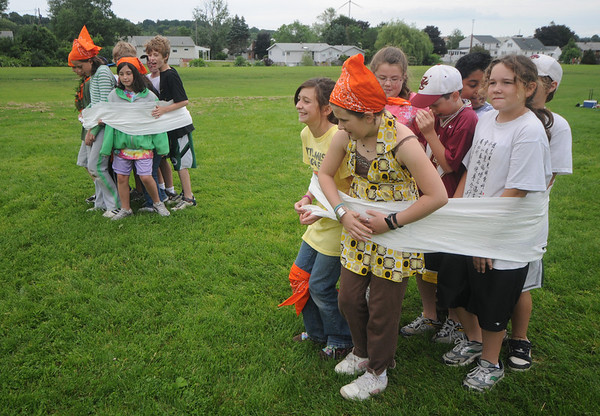 "Newburyport:Kids compete in  ""All Rolled Up"" during Survival Day at the Molin School Thursday. 4th and 5th graders emulated the TV show Survivor with 14 events testing the students skills and resolve. Jim Vaiknoras/staff photo"