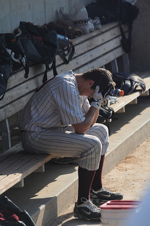 Lowell: Newburyport's John Isabel sits in the dugout after the Clipper's 4-3 loss to Georgetown Saturday at LeLacheur Field in Lowell.Jim Vaiknoras/staff photo