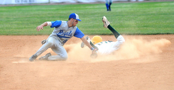 Lynn: Georgetown's Anthony Conte tags out North Reading's Darren Hartwell during the Royal's 2-1 victory at Fraser Field in Lynn. Jim Vaiknoras/staff photo