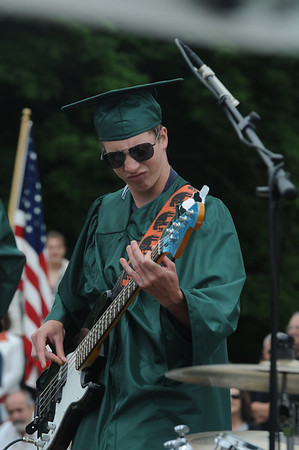 "West Newbury:Keith P.Mosley on bass along with  Matthew Robert Pendergast on guitar,  and Douglas ""Doogie"" Mead on drums rock the school song ""Alma Mater"" at the Pentucket Graduation Saturday morning.Jim Vaiknoras/staff photo"