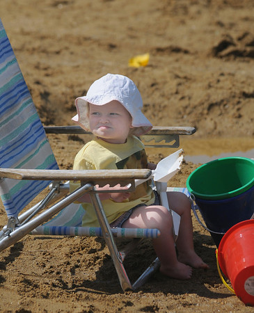 Amesbury: Baily Kimball, 1, catches some rays before digging in the sand Saturday morning at Family Fun Day at Lake Gardner in Amesbury. Jim Vaiknoras/Staff photo